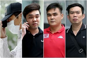 Mobile Air salesmen (from left) Koh Guan Seng, Kam Kok Keong, Lim Hong Ching, and Kelvin Lim Zhi Wei were each jailed between four and 14 months for engaging in conspiracy to cheat walk-in customers, on Wednesday, Oct 14, 2015.