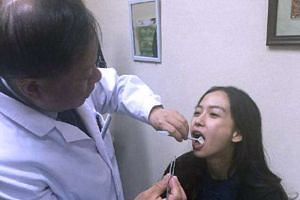 Angelababy being examined by a plastic surgeon.