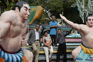 Tour operator Journeys' chairman of the board of directors Jeya Ayadurai (left) at Haw Par Villa with colleagues Savita Kasyhap and Chan Ying Loone, and park artisan Teo Veoh Seng (rear). In August, travel company Journeys was hired by the Singapor