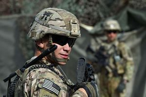A US army soldier stands guard at an Afghan National Army (ANA) base.