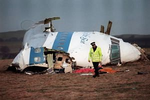 A file picture taken in Lockerbie on Dec 22, 1988 shows the wreckage of Pan Am flight 103 that exploded, killing all 259 people onboard.