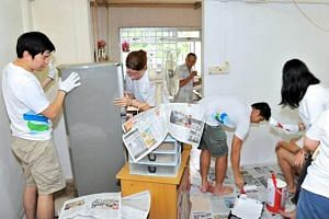 The home-refurbishmet project at Teck Ghee Community Care Corner involved 200 Standard Chartered staff volunteers.