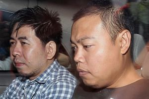 Iskandar Rahmat (right), who is standing trial for the murder of a father and son in Kovan on July 10, 2013.