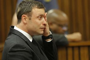 A Sept 11, 2014 photo shows Oscar Pistorius in the dock during his murder trial in Pretoria.
