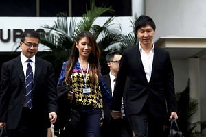 Lawyer Edwin Tong (left) with City Harvest Church founder Kong Hee (right) and his wife Ho Yeow Sun leaving court on Sept 17, 2013.