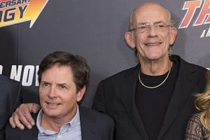 Actors Michael J. Fox (left) and Christopher Lloyd attend the Back to the Future 30th Anniversary screening in Manhattan on Oct 21, 2015.
