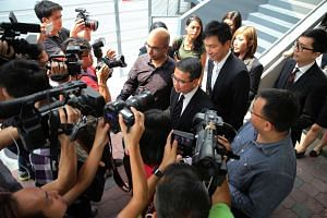 City Harvest Church founder Kong Hee and his wife Ho Yeow Sun at the State Courts on Oct 21, 2015.