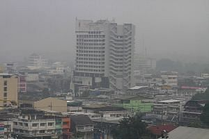 A view of Muang district in the southern province of Yala, Thailand, is pictured shrouded in haze yesterday. In many parts of southern Thailand, air pollutant readings were in the unhealthy range. According to the Ministry of Natural Resources and En