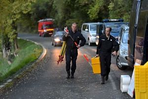 French investigators began on Saturday (Oct 24) trying to identify the bodies of 43 victims of a coach crash blaze near Bordeaux.