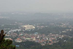 Thick haze engulfs the city of Davao, on the southern island of Mindanao, on Oct 23, 2015.