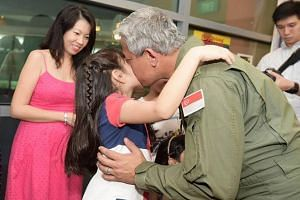 ME3 Brandon Joseph being welcomed home by his daughter and wife.