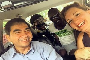 (From right) Humanitarian and social activist Lynsay Lewis, medical worker Innocent Rwamwiza and Ugandan acid attack victim Namale Allen got a free ride from a taxi driver (name unknown) who had read about Ms Allen's plight in The Sunday Times.