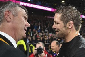 Meyer (left) shakes hands with New Zealand captain Richie McCaw after the match.