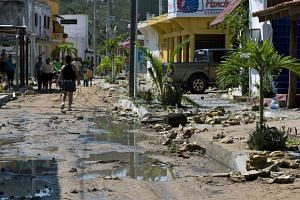 A street in Barra de Navidad, Jalisco state, partially destroyed after Hurricane Patricia hit the shore on Oct 24, 2015.