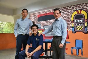 Assumption Pathway student Ng Wei Ming (centre), 19, works three days at a hotel and spends two days in school, where he gets to consult job coaches Royston Alvin Ang (far left) and Ronnie Ho.