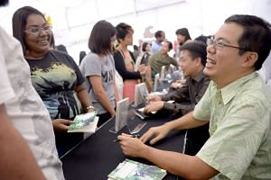 Poet Aaron Lee during a book signing session at the Singapore Writers Festival 2014.