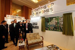 Mr Iswaran (second from left) touring an exhibition at the Singapore International Energy Week on Oct 26.