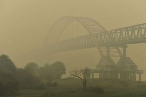 The Kahayan bridge is seen through a thick yellow haze in Palangkaraya, a city located in Indonesia's central Kalimantan.