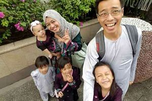 Nurul Asyikin Norman with her husband, Mohd Rizalludin Hassan (right), and their children.