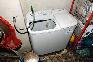 A woman has been arrested in connection with the newborn girl who was found dumped in a washing machine in Kampung Ulu Dulang Kecil.
