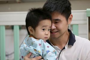 Mr Guo Yang with his son Jeremy on Aug 26, before the boy was discharged from hospital 25 days after his liver transplant operation. An ST team was allowed to document Jeremy's 12-hour transplant on Aug 1.