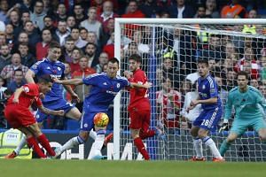 Liverpool's Brazilian midfielder Philippe Coutinho (L) shoots to score their second goal.
