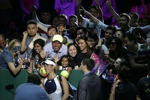 """Local and foreign fans taking a """"wefie"""" with Garbine Muguruza. Emerging stars like her are making up for the absence of some big names."""