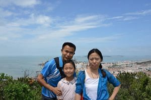 Ms Carol Feng with her husband Qu Hua and their 10-year-old daughter Shuyuan. The family lives in Beijing.