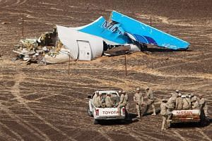 Egyptian servicemen approaching the wreckage of the Russian airplane in Sinai, Egypt, on Nov 1, 2015.
