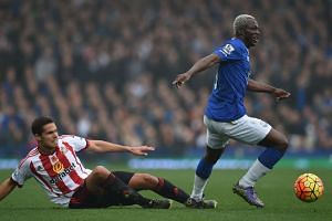 Sunderland midfielder Jack Rodwell (left) vies with Everton's Arouna Kone.