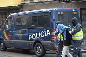 Spanish police arrest one of the three suspects.
