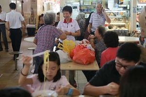 Minister for Culture, Community and Youth Grace Fu at Yuhua Village Market and Hawker Centre during general election campaigning period.
