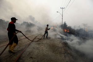 Indonesian firefighters putting out a fire in Banyuasin, South Sumatra.