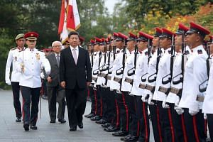 Chinese President Xi Jinping, accompanied by President Tony Tan Keng Yam, inspects the guard-of-honour during the welcome ceremony at the Istana, Nov 6, 2015.