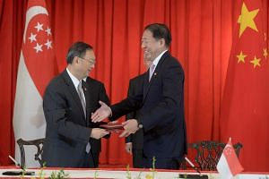 DPM Teo Chee Hean (right) with China's State Councillor Yang Jiechi signing the MOU for framework agreement between Singapore and China on the development of the China-Singapore (Chongqing) Demonstration Initiative on Strategic Connectivity in China.