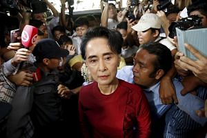 Myanmar's National League for Democracy (NLD) party leader Aung San Suu Kyi arrives to cast her ballot during the general election in Yangon on Nov 8, 2015.