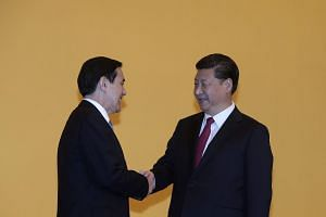Taiwanese President Ma Ying-jeuo (left) and Chinese President Xi Jinping (right) shake hands at the Shangri-La Hotel in Singapore, on Nov 7, 2015.
