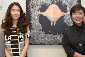 Eleanor Lee and mum Quan Yifeng (both above) with the 16-year-old's artwork done in collaboration with Chinese artist Wu Qiong.