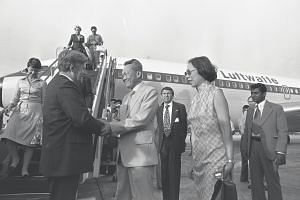 Then West German Chancellor Helmut Schmidt (left) arriving in Singapore for a two-day visit in 1978. He was greeted by Mr Lee Kuan Yew (centre) and his wife Mrs Lee.