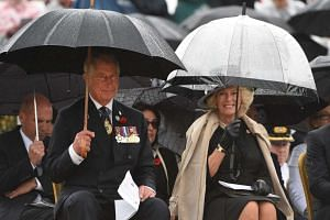 Britain's Prince Charles (left) and his wife Camilla, the Duchess of Cornwall (right), attend Remembrance Day commemorations at the Australian War Memorial in Canberra, Australia, on Nov 11, 2015.
