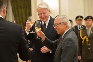 Icelandic President Olafur Ragnar Grimsson (centre), and President Tony Tan Keng Yam raising their glasses for a toast during the state banquet at the Istana last night. Dr Grimsson's three-day state visit to Singapore is the first by an Icelandic Pr