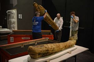 A mummy-board from Thebes dating back to the early 2nd Dynasty and the mummy of an adolescent boy, from Hawara, Egypt are unveiled at the National Museum of Singapore on Nov 13, 2015.