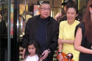 Property tycoon Joseph Lau (centre) with girlfriend Chan Hoi Wan and their daughter Josephine in Hong Kong.