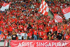 Singapore fans at the match between Singapore and Japan at the Singapore Sports Hub on Nov 12, 2015.