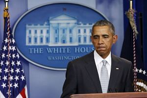 US President Barack Obama pausing while speaking about the shooting attacks in Paris on Nov 13, 2015.