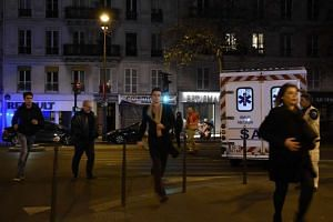 People fleeing the Oberkampf area following a series of terror attacks on entertainment sites at the same time in Paris.