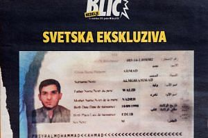 A photograph taken in Belgrade on Nov 15, 2015 shows the frontpage of Serbian magazine Blic, displaying a Syrian passport found by police at the scene of one of the Paris attacks.
