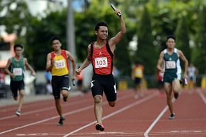 Syahirran Sadeli helping the Singapore Sports School (SSS) win the B Division overall title at the 54th National Inter-School Track & Field Championships.