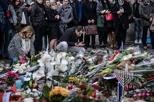 A Muslim man praying on Monday at a memorial site near the Bataclan concert hall, where most of the carnage occurred during last Friday's terror attacks in Paris. French Muslims have been included in the sense of unity in the wake of the attacks, wit