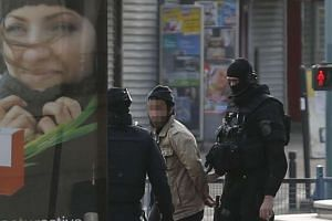 A man is evacuated after being arrested in Saint-Denis.